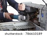 young woman cuts a metal case... | Shutterstock . vector #786610189