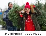 young couple buying christmas... | Shutterstock . vector #786644386