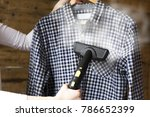 woman ironing shirt with... | Shutterstock . vector #786652399