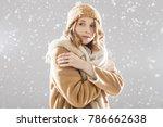 the girl in beige coat and cap... | Shutterstock . vector #786662638