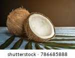 fresh coconuts on old wooden... | Shutterstock . vector #786685888