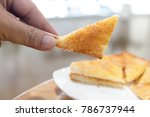 toast is cut into triangular... | Shutterstock . vector #786737944