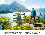woman hiker stands on the coast ... | Shutterstock . vector #786746626