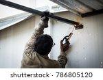 tame welder. the welder welds... | Shutterstock . vector #786805120