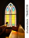 window and wooden pew in a...