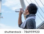 asian man is drinking water... | Shutterstock . vector #786959920