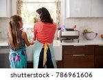 mum and daughter washing hands... | Shutterstock . vector #786961606