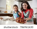 mother and daughter in kitchen... | Shutterstock . vector #786961630