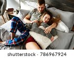 embraced couple relaxing in bed ... | Shutterstock . vector #786967924