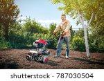 happy man farmer plows the land ... | Shutterstock . vector #787030504