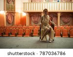 a girl in a vintage style sits... | Shutterstock . vector #787036786