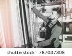 smiling workman deciding on... | Shutterstock . vector #787037308