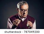 portrait of senior man who is... | Shutterstock . vector #787049200