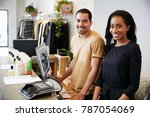 smiling colleagues behind the... | Shutterstock . vector #787054069
