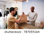 man serving customer at the...   Shutterstock . vector #787055164