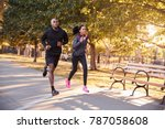 young black couple jogging in a ... | Shutterstock . vector #787058608