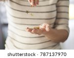 woman pours stars from hand to... | Shutterstock . vector #787137970