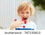 delighted kid  boy tasting ripe ... | Shutterstock . vector #787150813
