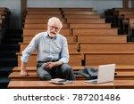 Smiling grey hair professor...