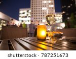 glass of white wine and candle... | Shutterstock . vector #787251673
