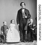 Small photo of George Nut, Charles Stratton , Lavinia Warren Stratton, and The Giant, c. 1863-65. All were performers for P.T. Barnums AMERICAN MUSEUM in New York City