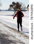 man jogging during winter   Shutterstock . vector #787442890