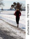 man jogging during winter   Shutterstock . vector #787442893