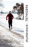 man jogging during winter   Shutterstock . vector #787442896