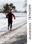 man jogging during winter   Shutterstock . vector #787442899