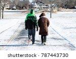 couple walking during winter | Shutterstock . vector #787443730