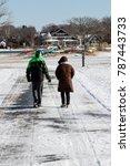 couple walking during winter   Shutterstock . vector #787443733