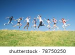 Group Of People Jump On Hill...