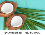 coconuts with leaves on wood... | Shutterstock . vector #787504903