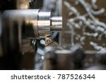 part production with lathe | Shutterstock . vector #787526344