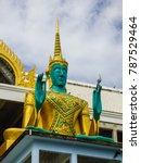 Small photo of Close up of green god statue at Buddhist temple Wat Kao Iti Sukato in Hua Hin, Thailand