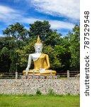 Small photo of Buddha statue near Buddhist temple Wat Kao Iti Sukato in Hua Hin, Thailand