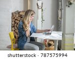 young beautiful woman works on... | Shutterstock . vector #787575994