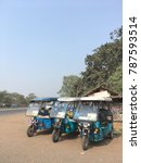 Small photo of Mecheda,Medinipore,India January 3rd 2017 Three wheel battery driven Rickshaw standing by the side of a highway
