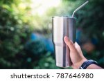 hand holding a stainless steel... | Shutterstock . vector #787646980