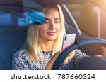 young smiling woman driver...   Shutterstock . vector #787660324