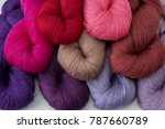 Small photo of Yarn skein, colorful thread in skeins, Red pink purple yarn collection