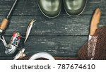 Small photo of Fishing gear - fishing, fishing, hooks and baits, on a wooden background. Toned image
