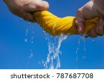 Small photo of Hands drying wet coth.