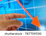 hand and graph on monitor screen | Shutterstock . vector #787709530