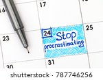Stock photo reminder stop procrastinating in calendar with pen close up 787746256