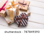 many gift boxes on white wooden ... | Shutterstock . vector #787849393
