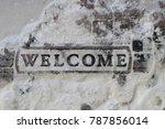 welcome door mat covered in snow | Shutterstock . vector #787856014