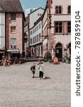 Small photo of FRANKFURT, GERMANY - July 03, 2017: Childrens stay on Frankfurt Christmas Market (Frankfurter Weihnachtsmarkt) in old town of Frankfurt am Main.