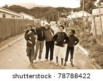 Small photo of KHAYELITSHA, CAPE TOWN - MAY 22 : A unidentified group of young teenager dance on a street of Khayelitsha township, the name is Xhosa for New Home on May 22, 2007, Cape Town, South Africa