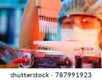 scientist loads pcr plate for... | Shutterstock . vector #787991923